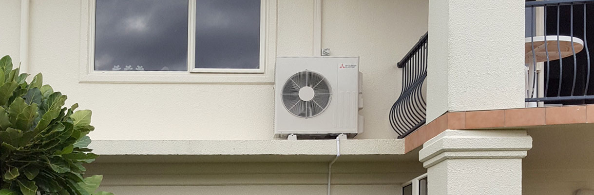 Heat pump unit in Papamoa, Tauranga, installed out of the way